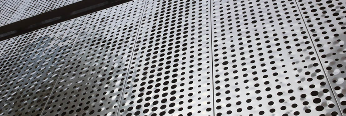 Perforated plate is covered on the surface of the building.