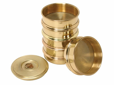 Several test sieves are made of brass perforated metal.