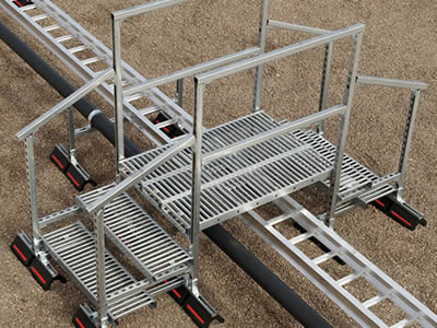 Cable tray is below a trapezoid interlocking non slip stair.