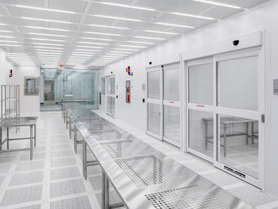 The floor where perforated metal tables arranged neatly are standing is made of perforated metal tiles in the cleaning room.