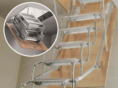 A folded perforated metal staircase with silver surface is in attic.