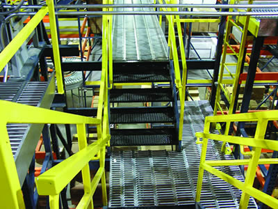 Interlocking stairs are made of metal interlocking stair treads and yellow fences.