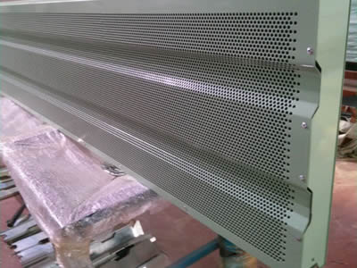 A piece of micro holes type noise barrier with round holes in staggered rows is laid vertically on the shelf.