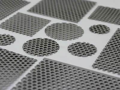 Several perforated filter discs with round holes have no margin.