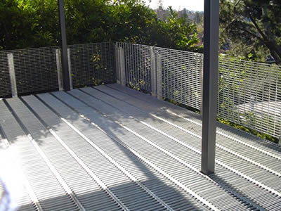 Non slip platforms made of interlock safety gratings are used in outdoor balcony.