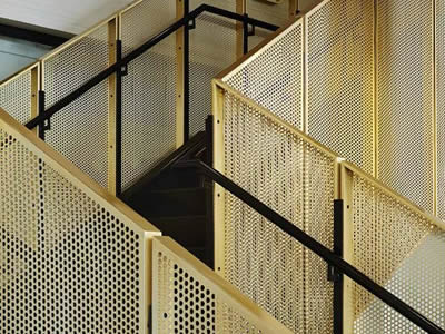Brass perforated metals are made into stairs infill railings.