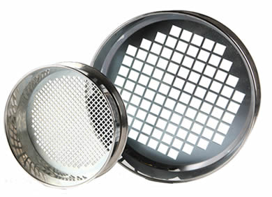 Two stainless steel perforated sieves with square holes.
