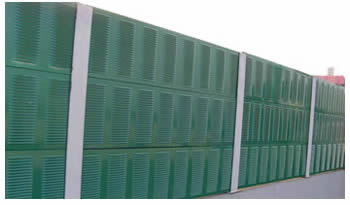 Green perforated louvers are installed on the side of the highway.