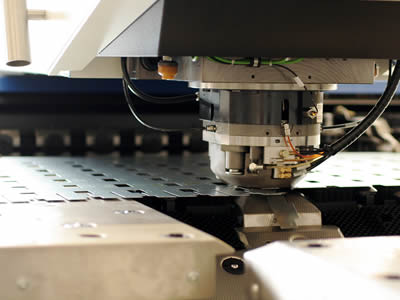 A perforated plated CNC equipment is punching.