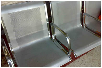 Two chairs are made of aluminum perforated screen and the arms of the chair is made of galvanized plate.