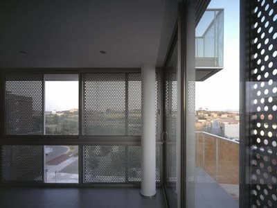 Perforated metals with round holes are made into balcony security screens.