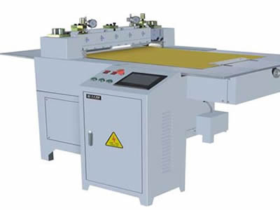 A perforated sheet cutting machine stands here.