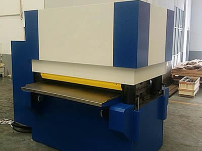 A punching plate leveling machine in the workshop.