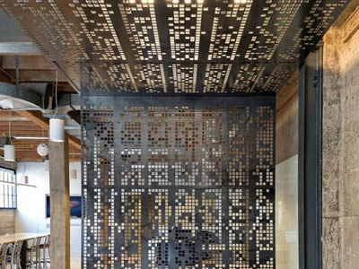 Two perforated metal sheets with square holes and beautiful patterns are used as ceiling on the top and a partition.