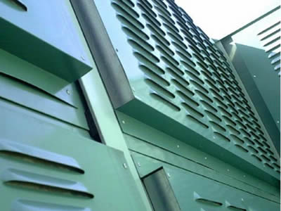 Many green noise barrier sheets with shutter holes are made up of noise barrier.